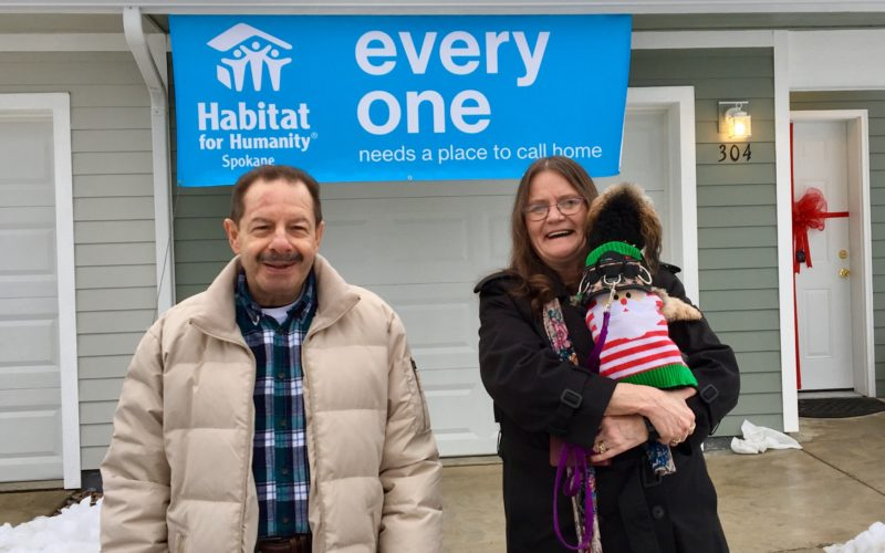 Three Habitat homeowners received their keys on Thursday